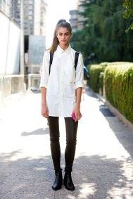 vit, överdimensionerad skjorta med knappar, svarta skinny jeans och läderstövlar