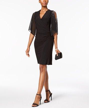 svart klänning med volang axel och V-ringning och chiffongöverdrag