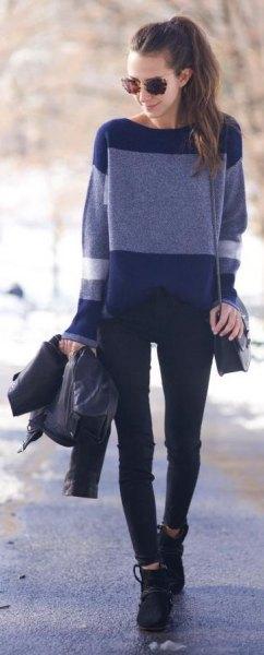 Marinblå och ljusblå tröja med svarta jeans