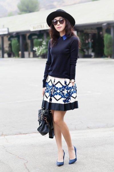 svart tröja med tribal tryckt mini veckad kjol