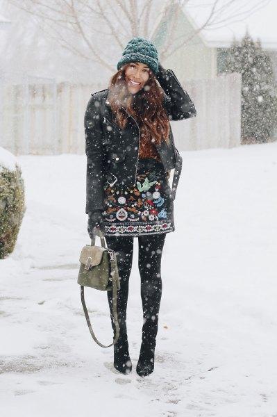 svart läderjacka stickad hatt