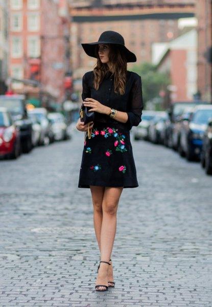 svart tröja floppy hatt broderad kjol