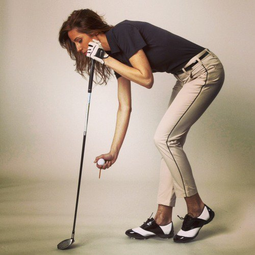 Kaki golfbyxor med svart polotröja