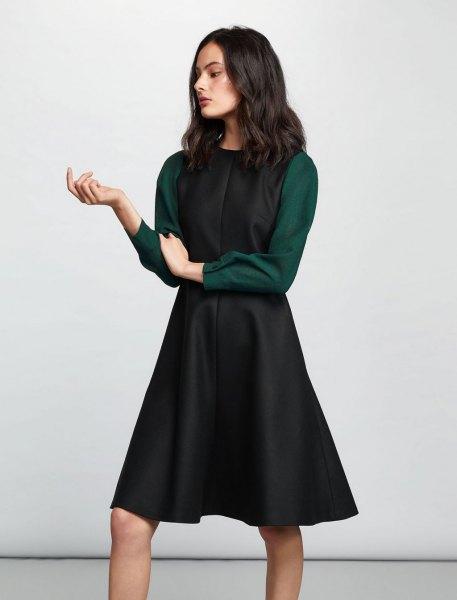 svart ull flare klänning grå ärmar