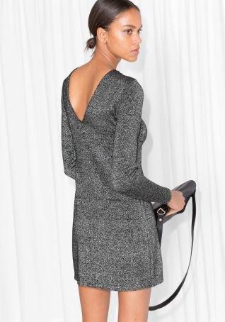 grå miniklänning i ull med låg rygg