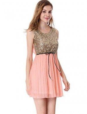 Gyllene paljettröja med rodnadrosa mini-chiffong veckad kjol