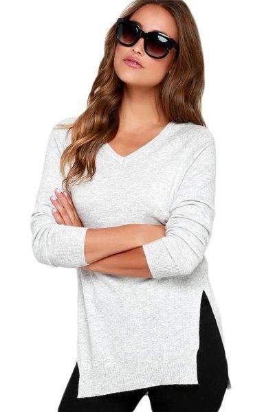 vit sidotröja med svarta skinny jeans med hög midja