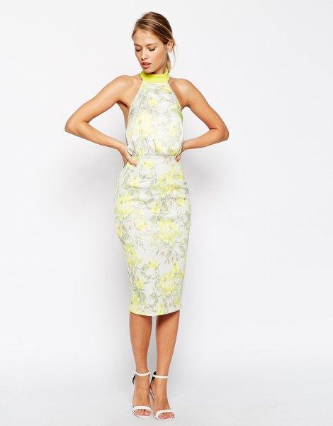 Sommarklänning med gul blommgrimma och midiklänning