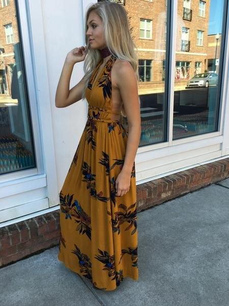 Backless maxi sommarklänning med blommönster i orange och svart
