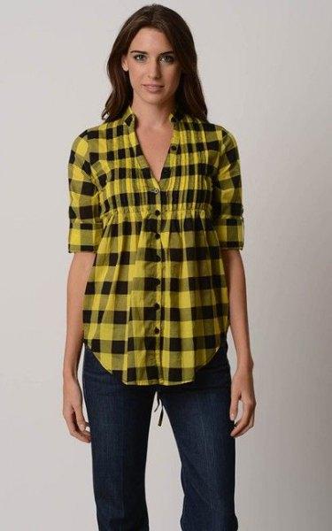 gul-svart rutig peplumskjorta med mörka skinny jeans