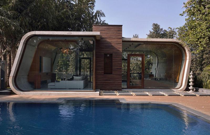 Böjda betonghytter: modern pool