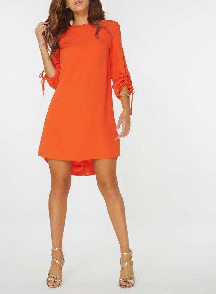 långärmad orange sväng miniklänning