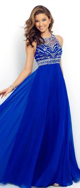 Kungsblå och silver paljett passform och flare halterneck klänning