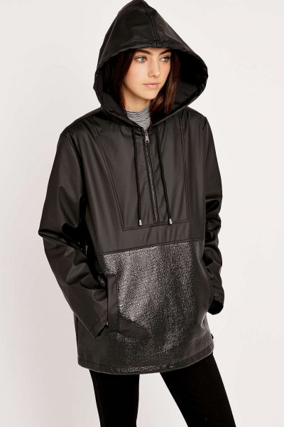 svart vindjacka i nylon och läder