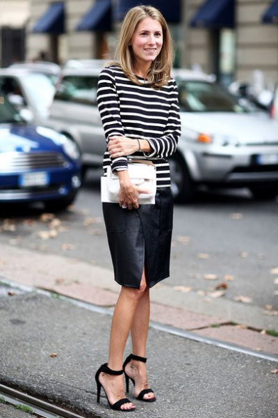 svart läder kjol med öppna tår och ankelrem