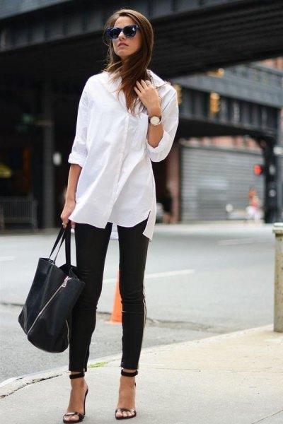 överdimensionerad vit skjorta med knappar svarta skinny jeans
