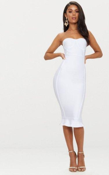 vit midiklänning med volangfåll