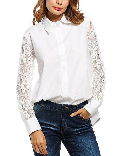 vit skjorta med knappar och spetsärmar