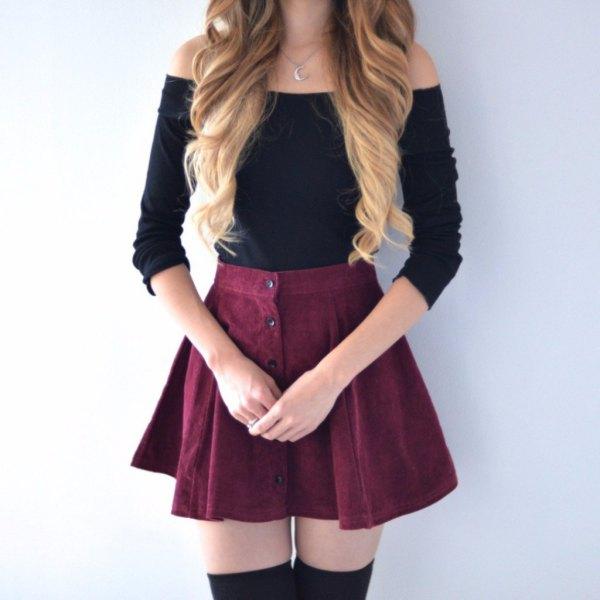 svart axelbandslös tröja med skater minikjol med knappfäste