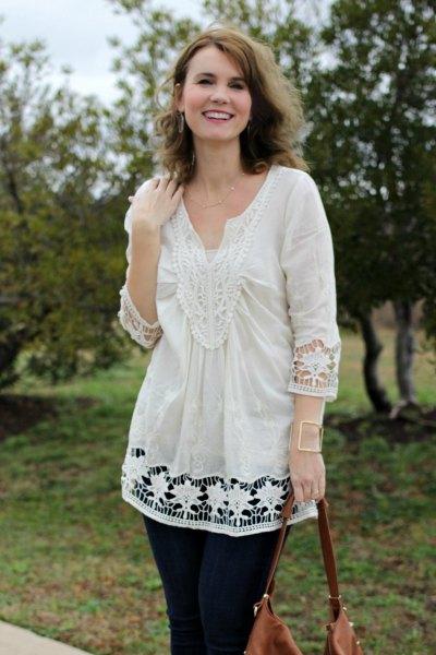 vit virkad spets tunikatopp med svarta skinny jeans