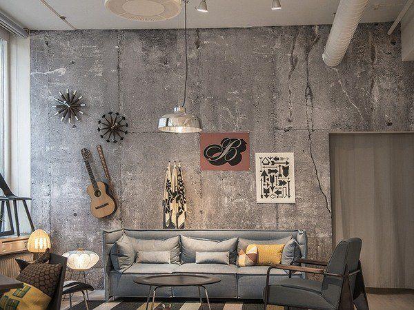 betongväggar idéer vardagsrum vägg dekorera idéer grå soffa.
