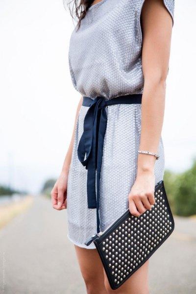 Blå tryckt sommarkunikatopp med halva ärmar och svarta, korta leggings