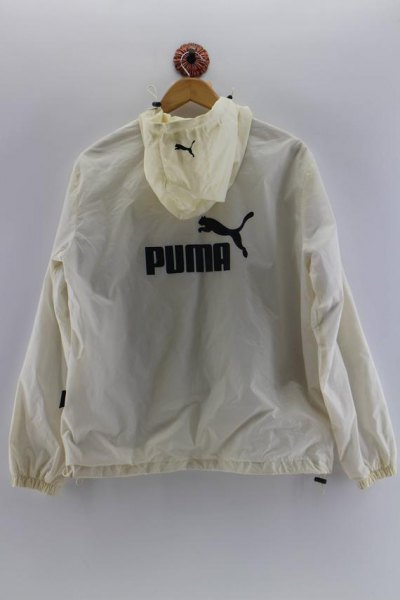 Ljusgul Puma vindjacka med ljusblå skinny jeans