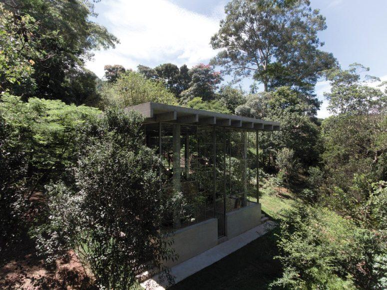 Glass och betong regnskog reträtt för en filosof - DigsDi