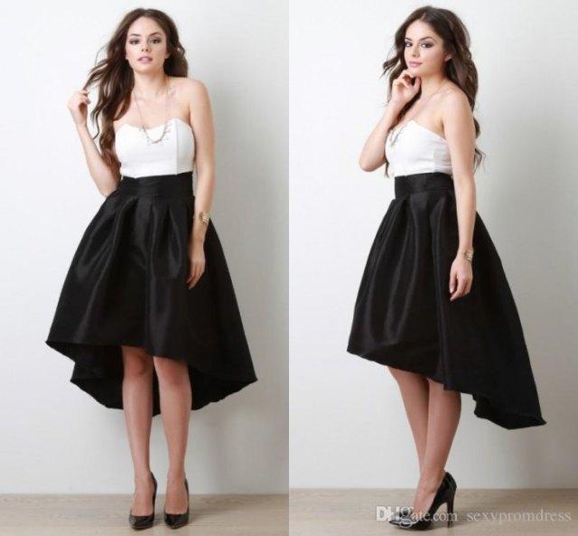 vit axelbandslös topp svart siden kjol med låg flare