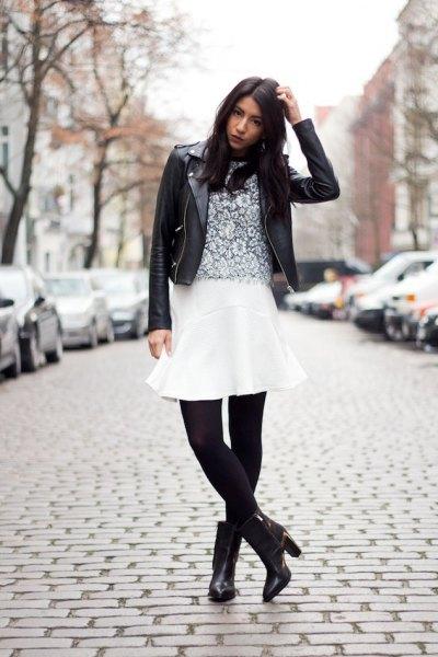 vit flare kjol svarta leggings stövlar