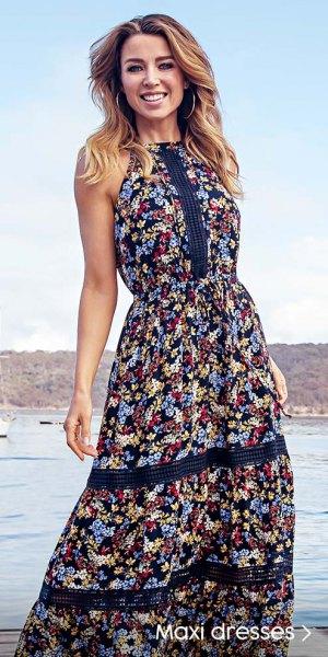 Blommig passform och svart maxiklänning i hawaiisk stil