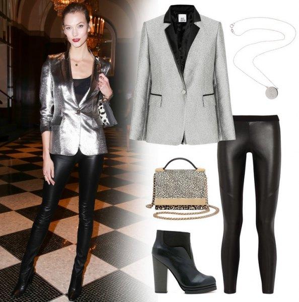 blank silverblazer med svarta läderbyxor