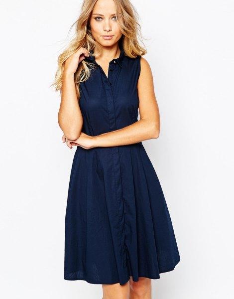 Marinblå knälång utvändig ärmlös skjortklänning