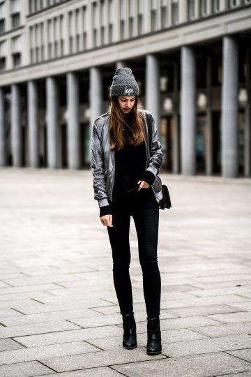 grå sammet bomberjacka med svarta supermagera jeans