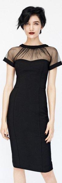 svart slida klänning med transparent krage