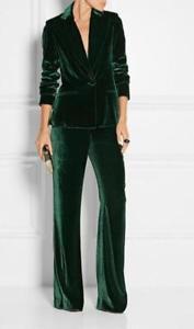 mörkgrön sammetdräktjacka med matchande vidbyxor