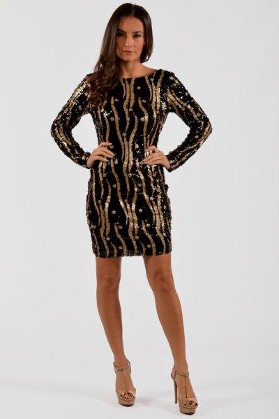 Svart och guld långärmad klänning med paljetter