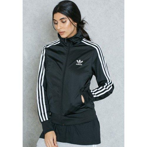 svartvitt randig sportjacka med mock-hals med dragkedja och lång-t-shirt
