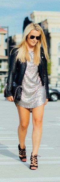 silverskiftklänning svart skinnjacka