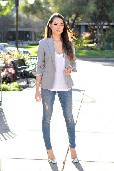 vita skinny jeans med V-ringning