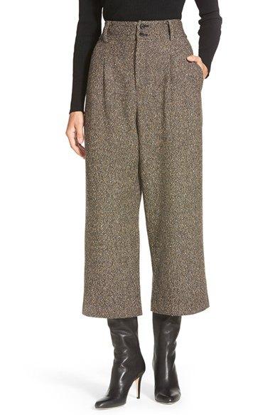 Byxor med vida ben och mid-rise läderstövlar