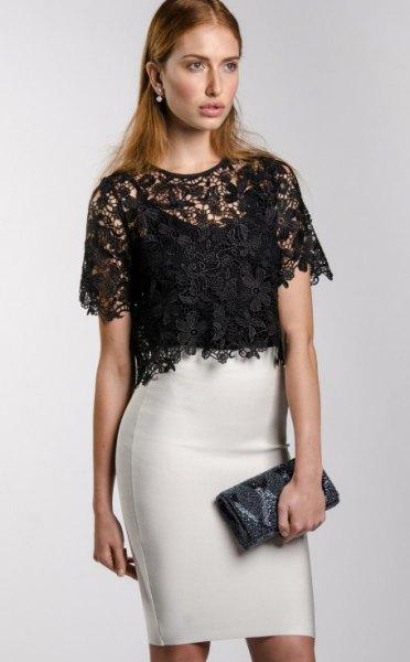 svart, kortärmad, elegant spetsblus med vit minikjol