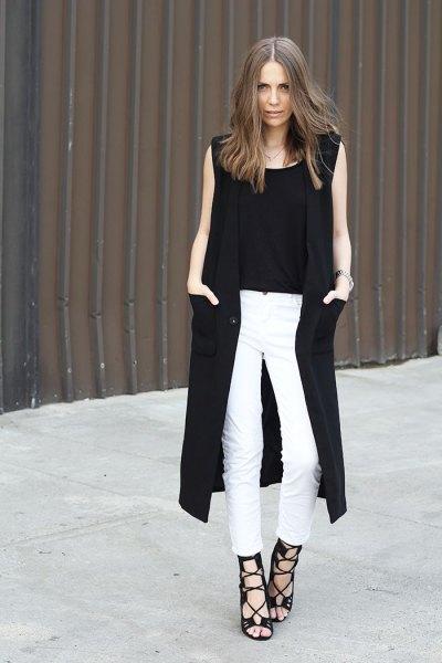 svart lång ärmlös väst vita smala jeans