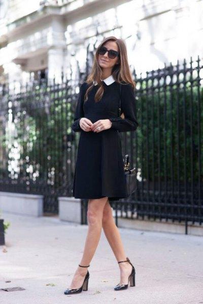 svart klänning med långärmad krage och spetsiga tåklackar med ankelband