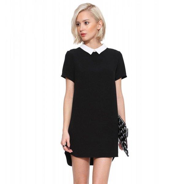 svart miniklänning med prickig paljettkoppling