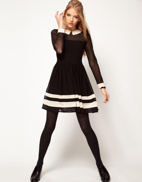 svartvitt randig, halvtransparent och fläckad miniklänning