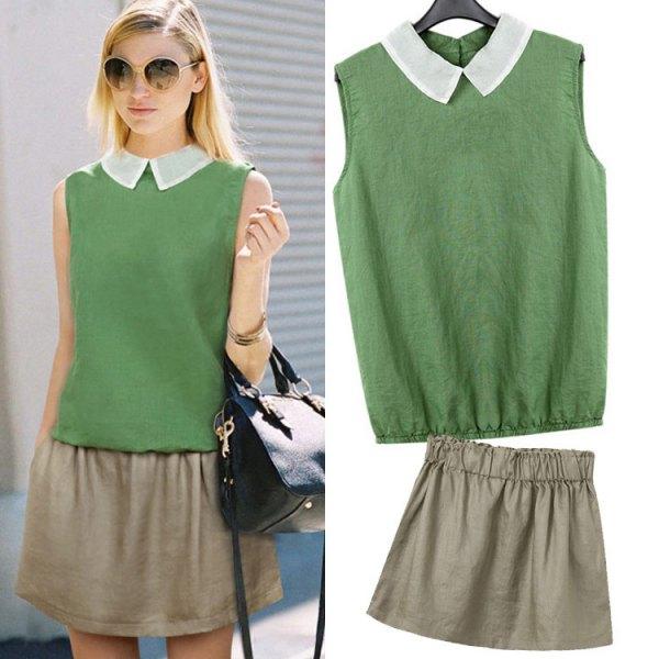 grön ärmlös skjorta med krage och miniraterad kjol
