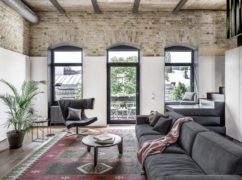 Minimalistisk lägenhet i två plan med en industriell känsla - DigsDi