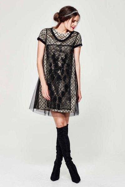 golden shift-klänning svart halvtransparent