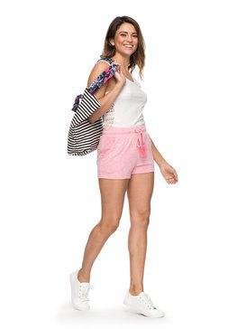 vit västtopp med ljusrosa mini-shorts